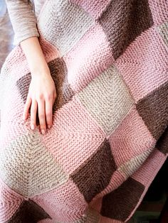 Paulie is a knitted blanket pattern that uses three shades of Berroco North Star. The throw is knit by making twelve modular blocks of four squares each, which are joined using a crocheted seaming method, with an I-cord edging for finishing. Download the free pattern at Berroco.com. #knittingpattern #freeknittingpattern