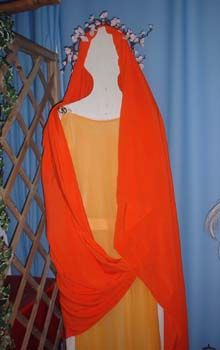 •	Flammeum—A veil of bright orange worn by Roman brides that covered the upper part of the brides face.