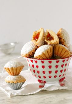 Italian Bocconotti Cookies are two bite morsels with a scalloped buttery shell. They're filled with fig jam and dusted with powdered sugar. Italian Almond Cookies, Italian Cookie Recipes, Italian Desserts, Jam Cookies, Biscotti Cookies, Galletas Cookies, Wine Recipes, Baking Recipes, Cookie Desserts