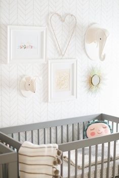 The Flower Pillow fits right in to this gender neutral nursery. Read More: http://www.stylemepretty.com/living/2015/05/04/a-gender-neutral-nursery-for-twins/