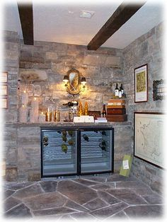 Love the stone for a home wine cellar