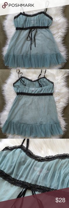 Victoria's Secret baby doll Item: Victoria's Secret baby doll Color: baby blue and black multicolor see pic Size: SMALL Condition: Preloved in great condition. String that goes under the breast are adjustable to your liking. Shoulder straps are adjustable. See thru. No rips or holes. Questions? Offers? Victoria's Secret Intimates & Sleepwear