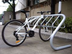 Outdoor Bike Racks Triangle Hanger Bicycle Rack SECURITY - designed to lock both the frame and wheel(s) of the bicycle SIMPLICITY - cyclists find the EXPO rack user friendly VERSATILITY - accepts all types of bicycles, tandems, tricycles and trailers