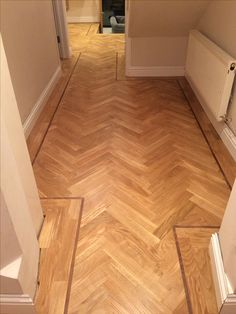 Oak parquet with walnut tramline laid sanded and sealed with Bona HD Traffic.