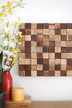 Create this wooden mosaic wall art with simple supplies you can find at the craft store! Click through for instructions.