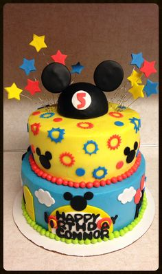 Micky mouse clubhouse cake.   Www.devinedelightsbyangie.com