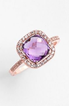 Purple sapphire ring set in rose gold.