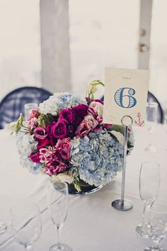 Pretty nautical centerpieces. Photography: Khaki Bedford Photography - www.khakibedfordphoto.com/, Floral Design: Thorn Bird Floral Boutique - http://www.tbirdwatermill.com  Read More: http://www.stylemepretty.com/2014/05/19/nautical-long-island-wedding/