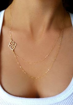 This gorgeous gold filigree sideways necklace features layered chains with a filigree pendant on the side and adjustable lobster closure. | Lookbook Store