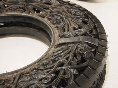Intricately Carved Rubber Tire. I would have this as a wreath on the garage door for austin haha