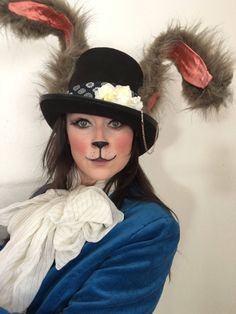 The March Hare Top Hat, rabbit ears, Alice in Wonderland, tea party, Mad Hatter Party, adult costume, Halloween costume, Top Hat by UncommonAnthology on Etsy https://www.etsy.com/listing/561174599/the-march-hare-top-hat-rabbit-ears-alice