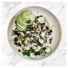 A healthy plate of quinoa, cucumber, avocado, mixed seeds & parsley...#recipes