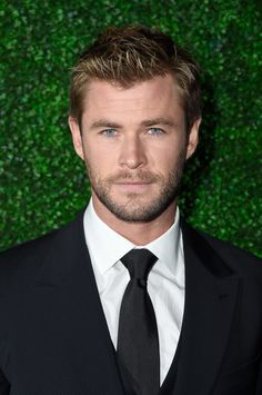 There have been more than a few hot Chris Hemsworth appearances over the years! Long hair, short hair — everything works on the handsome actor. Look back at some of his sexiest red carpet moments!