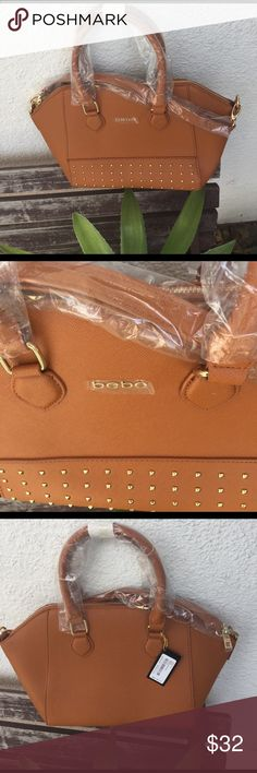 """Bebe Brooklyn studded satchel 🍁 Brand new Bebe Brooklyn studded satchel in cognac. It's brand new with tags. It comes with an adjustable removable strap. It has plenty of interior pockets to keep things organized and it's measurements are 15.5"""" W by 8.75"""" H 🍂🍂🍂 take this beauty before it's gone. bebe Bags Satchels"""