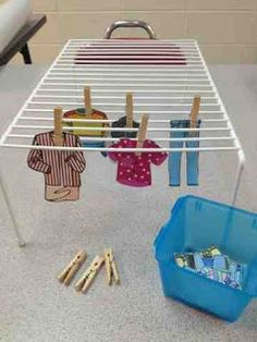 Adaptive Tasks: Hanging Clothes Task. Wire rack, clothespins, and clothing made of felt, fabric, or paper.