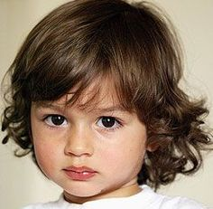 Exactly what I think of when I think of mine and Walter's children. Curly brown hair (me), big brown eyes (him), big lips (him), and fair skin (me).