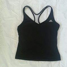 Adidas womens workout tank with mesh backing Women's workout tank with built in sports bra. Back is made of mesh for climate control. Signature Adidas three stripes across the back.  Tag says large but it feels more like a medium. Adidas Tops Tank Tops