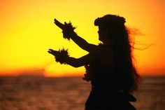 Hula dancer at sunset. Image by Ann Cecil / Lonely Planet Images / Getty