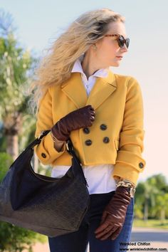 burgundy leather gloves and yellow jacket