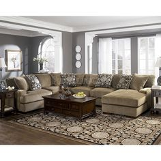 gray walls, tan couch.. didn't think it would work but I like it :)   Grenada - Mocha Large Sectional Living Room Set