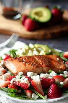 Salmon avocado salad with maple balsamic reduction, strawberries and goat cheese. Healthy, grain free, primal, soy free and easy to make! Strawberry Avocado Salad, Blueberry Salad, Salmon Avocado, Salmon Salad, Balsamic Salmon, Maple Balsamic, Best Salads Ever, Savory Salads, Healthiest Seafood