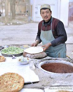 Uyghur making garlic naan, Turpan Xinjiang, China