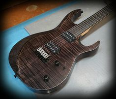 Kiesel Guitars Carvin Guitars  A6 (Aries Model) in deep black over flamed maple top and ash body! in antique ash treatment