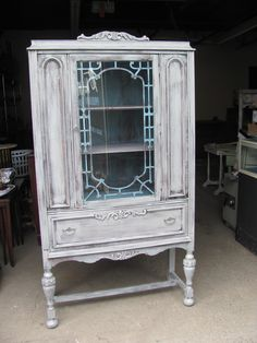 Vintage Shabby Chic Distressed China Cabinet. $250.00, via Etsy.