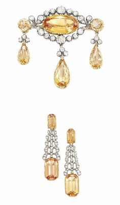 A 19TH CENTURY TOPAZ AND DIAMOND DEMI-PARURE   Comprising a pair of earrings of tapering form, the topaz tops each suspending an old-cut diamond pierced panel of stylised curling foliate motifs, to articulated topaz drops, together with a brooch of girandole form, the central oval mixed cut topaz and old-cut diamond cluster suspending three articulated topaz drops each with diamond trefoil surmount, mounted in silver and gold, 6.3cm and 4.4cm long respectively, antique fitted case