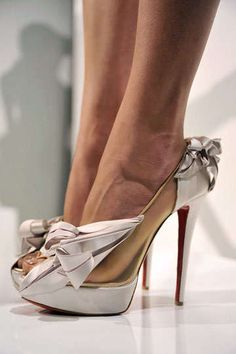 These are insane. I LOVE them.    Louboutin for Marchesa spring 2010
