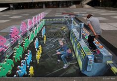Augmented Reality gives birth to a new dimension in 3D street art. Description from streetpainting3d.com. I searched for this on bing.com/images