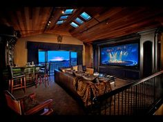 Homeowners are using technology to create entertainment rooms with superb sound and video quality plus a high-end design aesthetic. These rooms make great home theaters, but they also work just as well for cocktail gatherings. In the project seen here, Genesis Audio