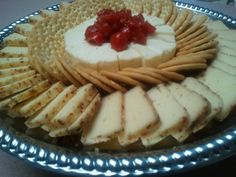 Rustic Cheese tray with tomatoe relish and tuscan cheese with crackers http://goldcoasteventservices.vpweb.com