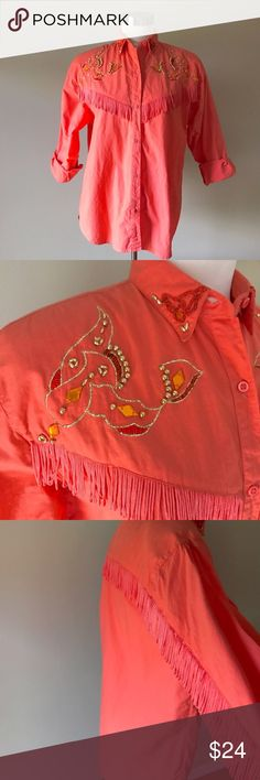"""Vintage Cowgirl Beaded Western Shirt with Fringe Such a fun color in this western shirt! Fringe along arms and back. Beading and gold embroidery on chest and collar points. Labeled as a size S. Measures 21.5"""" armpit to armpit and 27.5"""" shoulder to longest point of front hem. In very good vintage condition. One faint spot of discoloration as shown in last pic.   ✅ Offers  ✅ Bundle discounts  ❌ Trades Vintage Tops Button Down Shirts"""