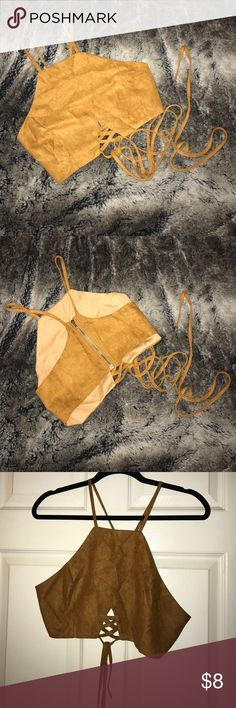 ✨Boutique suede wrap around crop top! Suede wrap around crop top! From a boutique. Has long straps that wrap around body multiple times and tie. Zip up back. Size medium.                      ✨Accepting reasonable offers! ✈️Always super fast shipping! Tops Crop Tops