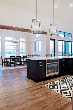 Love the hardwoods, over in the peninsula, all the windows, exposed beam, light fixtures.