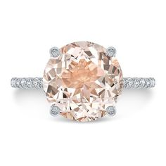 This stunning ct. morganite and diamond engagement ring will sweep her off her feet. Bright and beautiful center stone is eye clean. Simple rose gold shank encrusted with diamonds. Huge, beautiful round cut morganite grasped with diamond set prongs. Vintage Engagement Rings, Diamond Engagement Rings, Morganite Engagement, Morganite Ring, Anniversary Rings, Diamond Are A Girls Best Friend, Wedding Bands, Wedding Ring, Dream Wedding