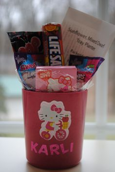 Hello Kitty Valentine and party favor. Use our idea or create your own - these pots are adorable and come with fresh flower seeds and ptting material. #hellokitty #valentinesday #hellokittyfavor