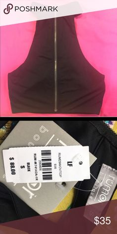 NWT LF HALTER ZIP UP CROP TOP IN BLACK Super cute and fierce! Matches literally everything and can be dressed up or down! HALTER style with an open back! Latest season! Msrp: $97 with tax, my price is very reasonable, please remember that poshmark has fees! Great wardrobe staple piece! Selling it at a loss but that's your gain!!! LF Tops Tank Tops