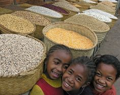 3 little girls on the market, Antananarivo, Madagascar.