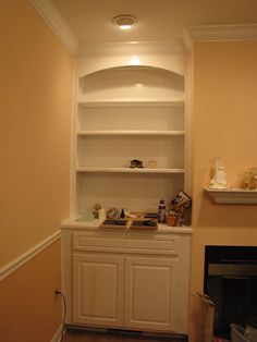 Built in cabinets and trim flanking fireplace - this is what I want