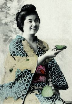Informal portrait of a young woman in kimono.  Hand-colored photo, 1890's, Japan.  Photographer K. Tamamura