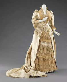 Charles Frederick Worth (French (born England)  ca. 1885  French  silk, linen -  This grand dress was worn for a presentation to Princess Alexandra of Denmark (1844-1925) at the court of Queen Victoria (1819-1901). Being presented to royalty was an aspiration for many Americans at the time and justifies the purchase of such an elaborate gown for such a situation.