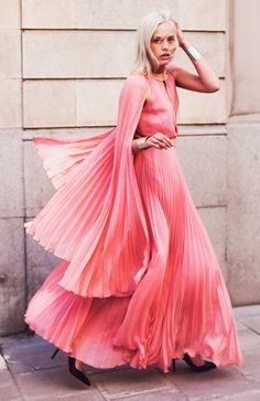 Pleated gown. Reminds me of Miss.Piggy's dress in the runway/synchronized swimming scene in The Great Muppet Caper.