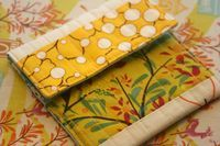 """This a great way to use up both batting and fabric scraps. ** You can easily make more than one at a time if you use longer strips (say 11"""" or longer) and then just trim them down to 5""""..."""