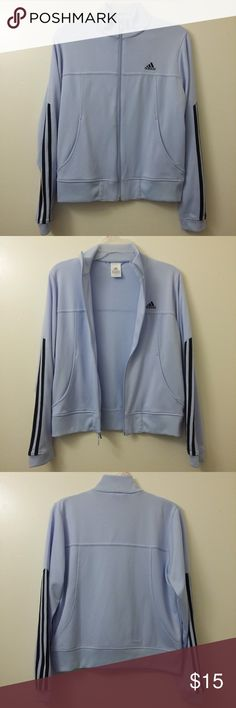 Adidas Women's Medium Track Jacket A timeless style, crafted with new sustainability. This women's track jacket has a heritage look in shiny tricot material made of 100% recycled fibers. 3-Stripes down the sleeves and a big Trefoil logo at right chest keeps the look true to the authentic design.  Features - Great Condition (no hole or odor, tiny pulling near logo) - 100% Polyester - Two Pockets - Ribbed cuffs and bottom hem adidas Jackets & Coats