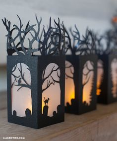 DIY Halloween Decorations. These mini lanterns are cut from one sheet of 8.5 x 11black metallic paper and use a half sheet of white vellum to make the frosted windows. Pattern at http://liagriffith.com/diy-paper-lanterns-for-halloween-decorations/