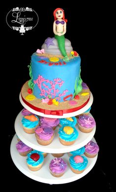 Mermaid theme cake and matching cupcakes. Under the sea lizzystreats.com