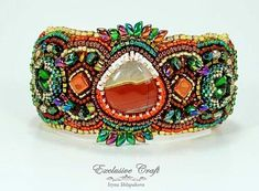 "Colorful and unique bead embroidered bracelet ""Firebird"" made with Mookaite cabochon, Swarovski crystals, red Agate cabochons and Japanese seed beads."