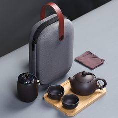 Travel tea set portable bag fast passenger cup one teapot two cups purple sand kung fu travel teapot Material: Purple sand Origin: Dehua, Quanzhou, Fujian Dimensions and Capacity: Teacup: × capacity: Teapot: × capacity: Tea caddy: × capacity: Tea Cup Saucer, Tea Cups, Tea Rose Garden, Roses Garden, Pottery Handbuilding, Campaign Furniture, Tea Pot Set, Tea Caddy, Chinese Tea